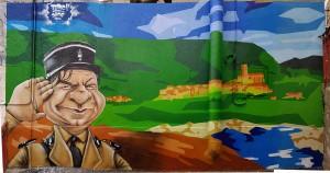 Michel Galabru a grandi au Bousquet d'Orb (fresque décorant la terrasse du Bouchon d'Orb)